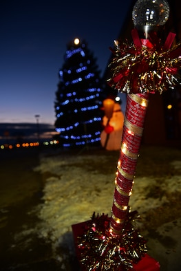 The Freedom Chapel Christmas tree illuminates the night at Ellsworth Air Force Base S.D., Dec. 1, 2016. The lights were switched on by children of deployed Airmen during the 28th Bomb Wing tree lighting ceremony. (U.S. Air Force photo by Airman 1st Class James L. Miller)