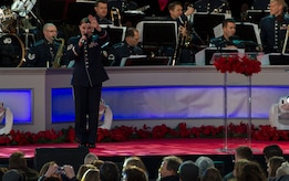 Tech. Sgt. Paige Wroble, the U.S. Air Force Band's Airmen of Note vocalist, sings during the 2016 National Christmas Tree Lighting Ceremony in Washington, D.C., Dec. 1, 2016. The Airmen played from the start to finish of the ceremony, providing instrumentals to artists like Chance the Rapper, Kelly Clarkson, James Taylor and the Lumineers. (U.S. Air Force photo by Senior Airman Jordyn Fetter)