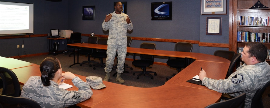 Master Sgt. George Higgins, Air Force Reserve recruiter briefs active duty service members about the palace chase program Dec. 1 at Joint Base San Antonio-Randolph. This program allows active-duty members to separate early in exchange for an additional commitment with the AFR or Air National Guard.