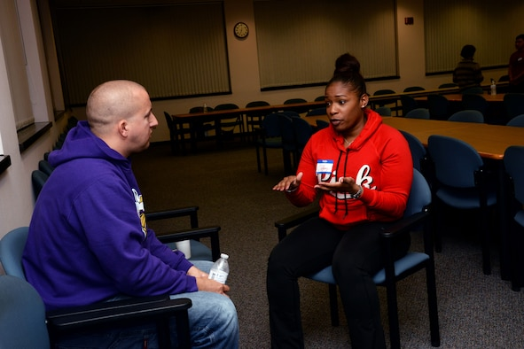 Master Sgt. Tiffany Jones, Senior Noncommissioned Officer Academy student, sits down and speaks with SSgt. Garrett Watson, 42nd Security Forces Military Working Dog trainer, during a Straight Talk Mentoring event, Dec. 1, 2016 at Maxwell Air Force Base Gunter Annex, Ala. Airmen ranging from the ranks of airman basic through staff sergeant were invited to the quarterly Straight Talk Mentoring event held at the SNCOA Library to have group and one-on-one discussions with SNCOs from bases and career fields across the Air Force. (U.S. Air Force photo/Senior Airman Alexa Culbert)
