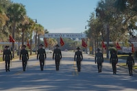 Drill instructors of Echo Company, 2nd Recruit Training Battalion, and Papa Company, 4th Recruit Training Battalion, retire the guidons Dec. 2, 2016. The guidons are retired after each platoon graduates.