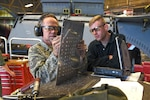 Air Force Tech. Sgt. Steven Olander, 141st Maintenance Squadron aircraft structural maintenance technician, left, and Senior Airman Logan Lingren, 92nd MXS aircraft structural maintenance technician, create a sidewall skin for the left landing gear wheel well, at Fairchild Air Force Base, Washington, Nov. 15, 2016. The skin replaced a portion of metal in the left landing gear wheel well affected by corrosion. Air Force photo by Senior Airman Mackenzie Richardson