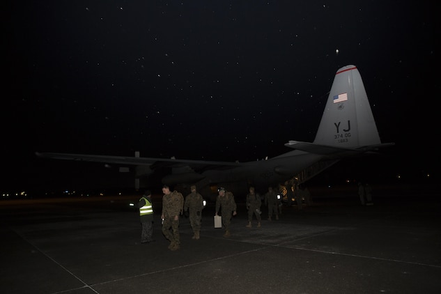 U.S. Marines with Marine Attack Squadron 542 (VMA) 542, exit a U.S. Air Force C-130J upon their arrival at Chitose Air Base, Japan, Dec. 2, 2016. VMA-542 journeyed to Chitose to partake in the Aviation Relocation Training program in an effort to increase operational readiness between the U.S. Marine Corps and the Japan Air Self Defense Force, improve interoperability and reduce noise concerns of aviation training on local communities by disseminating training locations throughout Japan.