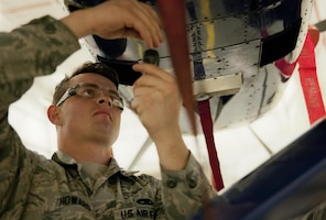 Staff Sgt. Michael Howard, 592nd Special Operations Maintenance Squadron perform maintenance on the fuel systems of a C-145 Skytruck in a hangar at Duke Field Fla., Feb. 25.  The Airmen are part of the fuel systems shop within the 919th Special Operations Maintenance Group.  (U.S. Air Force photo/Tech. Sgt. Sam King)