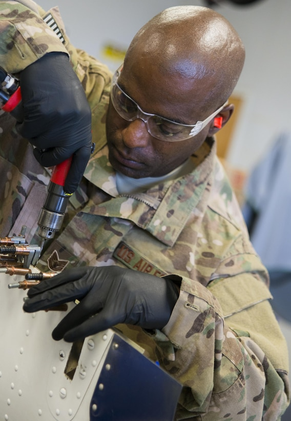 Tech. Sgt. Rodrick Hall, 919th Maintenance Squadron, replaces a broken piece of equipment off of a C-145 Skytruck at Duke Field, Fla., Feb. 25.  Hall is part of the 919th Special Operations Maintenance Group's fabrication shop.  (U.S. Air Force photo/Tech. Sgt. Sam King)