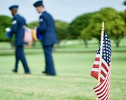 U.S. Air Force Staff Sgt. Johnnie Anderson and Airman 1st Class Andrew Titus, dental technicians with the 15th Aeromedical Squadron, walk among gravemarkers after having placed a commerative U.S. flag at the National Memorial Cemetery of the Pacific, Honolulu, Hawaii, Dec. 3, 2016. Anderson and Titus placed multiple flags during a commemoration ceremony honoring the courage, service and sacrifice of the U.S. military personnel who died during the attacks on Pearl Harbor and Oahu on Dec. 7, 1941. Dec. 7, 2016 marks the 75th anniversary of the attacks and the U.S. military and the State of Hawaii are hosting a series of remembrance events to honor the Pacific Theater's veterans. (U.S. Air Force photo by Tech. Sgt. James Stewart/Released)