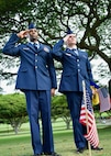 U.S. Air Force Staff Sgt. Johnnie Anderson and Airman 1st Class Andrew Titus, dental technicians with the 15th Aeromedical Squadron, salute a fallen U.S. servicemember's  gravemarker at the National Memorial Cemetery of the Pacific, Honolulu, Hawaii, Dec. 3, 2016. Anderson and Titus placed multiple flags during a commemoration ceremony honoring the courage, service and sacrifice of the U.S. military personnel who died during the attacks on Pearl Harbor and Oahu on Dec. 7, 1941. Dec. 7, 2016 marks the 75th anniversary of the attacks and the U.S. military and the State of Hawaii are hosting a series of remembrance events to honor the Pacific Theater's veterans. (U.S. Air Force photo by Tech. Sgt. James Stewart/Released)