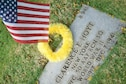 A commemorative U.S. flag rests next to U.S. Army Air Forces Pfc. Clarence Hoyt's gravemarker at the National Memorial Cemetery of the Pacific, Honolulu, Hawaii, Dec. 3, 2016. The flag was placed by U.S. Airmen during a commemoration ceremony honoring the courage, service and sacrifice of the U.S. military personnel who died during the attacks on Pearl Harbor and Oahu on Dec. 7, 1941. Dec. 7, 2016 marks the 75th anniversary of the attacks and the U.S. military and the State of Hawaii are hosting a series of remembrance events to honor the Pacific Theater's veterans. (U.S. Air Force photo by Tech. Sgt. James Stewart/Released)