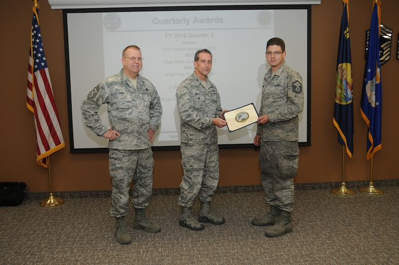 120th Airlift Wing Vice Commander Col. Thomas Mora and 120th AW Command Chief Master Sgt. Steven Lynch presented the Fiscal Year 2016 3rd quarter award winners for the 120th Airlift Wing of the Montana Air National Guard during the Stand-up Briefing held in the Larsen Room of the wing headquarters building Nov. 4, 2016. Master Sgt. Anastacio Navarro, an airlift aircraft maintenance craftsman assigned to the 120th Maintenance Group, was awarded the Innovator of the Quarter Award.
