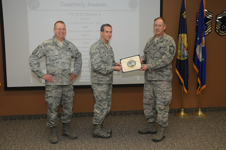 120th Airlift Wing Vice Commander Col. Thomas Mora and 120th AW Command Chief Master Sgt. Steven Lynch presented the Fiscal Year 2016 3rd quarter award winners for the 120th Airlift Wing of the Montana Air National Guard during the Stand-up Briefing held in the Larsen Room of the wing headquarters building Nov. 4, 2016. Senior Master Sgt. Wayne Bonderenko accepted the  Team of the Quarter Award on behalf of the 120th Maintenance Group propulsion shop.