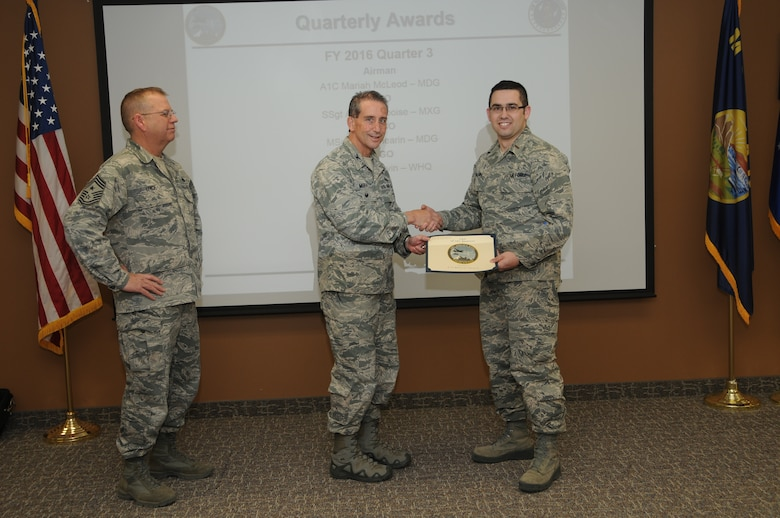 120th Airlift Wing Vice Commander Col. Thomas Mora and 120th AW Command Chief Master Sgt. Steven Lynch presented the Fiscal Year 2016 3rd quarter award winners for the 120th Airlift Wing of the Montana Air National Guard during the Stand-up Briefing held in the Larsen Room of the wing headquarters building Nov. 4, 2016. 120th Wing Headquarters Squadron Budget Officer 2nd Lt. Bradley Gauvin received the Company Grade Officer of the Quarter Award.