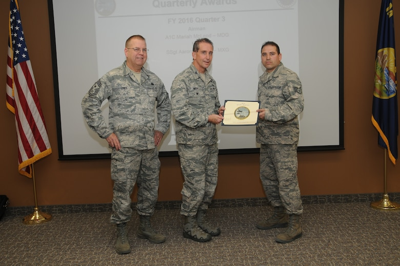 120th Airlift Wing Vice Commander Col. Thomas Mora and 120th AW Command Chief Master Sgt. Steven Lynch presented the Fiscal Year 2016 3rd quarter award winners for the 120th Airlift Wing of the Montana Air National Guard during the Stand-up Briefing held in the Larsen Room of the wing headquarters building Nov. 4, 2016. Aircraft Structural Maintenance Craftsman Staff Sgt. Aaron Duboise from the 120th Maintenance Group received the award in the noncommissioned officer category.