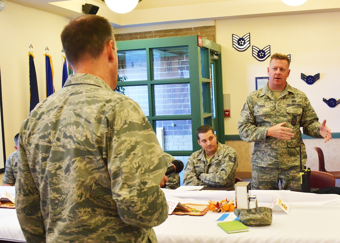 120th Airlift Commander Col. Lee Smith takes a question on awards and decorations from Tech. Sgt. Lance Turner during his lunch and learn event for Airmen held in the 120th AW Dining Facility on the base in Great Falls, Mont. November 6, 2016. (U.S. Air National Guard photo by Senior Master Sgt. Eric Peterson)