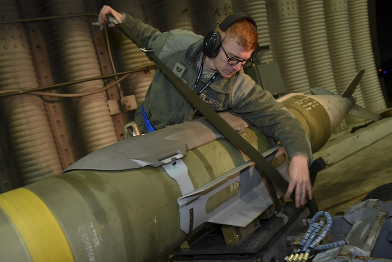 Staff Sgt. Kenneth Gullette, 35th Aircraft Maintenance Unit weapons load crew chief, straps a Joint Direct Attack Munition GBU-31 onto an MJ-1 Lift Truck at Kunsan Air Base, Republic of Korea, Nov. 30, 2016. Members of the 35th AMU train to safely load, unload, and properly position munitions onto F-16 Fighting Falcons. (U.S. Air Force photo by Senior Airman Michael Hunsaker/Released)