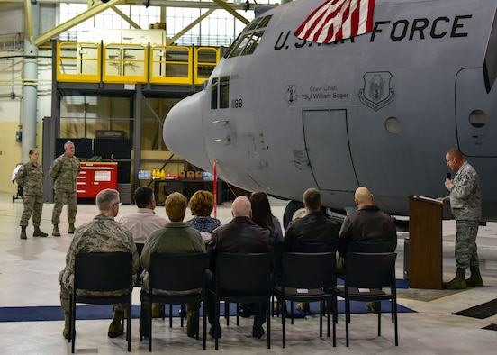 Family members and friends gather for the dedication of a C-130 Hercules at Niagara Falls Air Reserve Station on December 3, 2016. The dedication honors former 107th Airlift Wing member, Tech. Sgt. William C. Sager who passed away in 2014. (U.S. Air Force photo by Staff Sgt. Richard Mekkri)