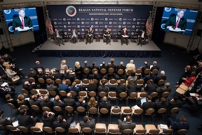 Deputy Defense Secretary Bob Work, second from right on stage, and other defense leaders participate in a panel discussion at the Reagan National Defense Forum in Simi Valley, Calif., Dec. 3, 2016. DoD photo by Army Sgt. Amber I. Smith