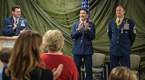 JOINT BASE ELMENDORF-RICHARDSON, Alaska -- Attendees applaud for Chief Master Sgt. Paul Bear Barendregt, a pararescueman and chief enlisted manager for the Alaska Air National Guard's 212th Rescue Squadron, at the conclusion of his retirement ceremony at the 212th's headquarters building here Dec. 3, 2016. Through his skill and commitment Barendregt exemplified the motto of the Air Force Pararescueman: These things we do, that others may live. (U.S. Air National Guard photo by Staff Sgt. Eagerton/released)