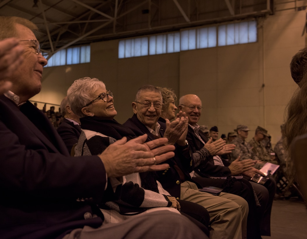 Retired Maj. Gen. Stanley Newman, former 137th Special Operations Wing commander, and retired Maj. Gen. Rita Aragon, Oklahoma Secretary of Veterans of Affairs, interact in the audience of the re-designation ceremony at the 137th Special Operations Wing at Will Rogers Air National Guard Base, Oklahoma City, Dec. 3, 2016. The ceremony marks the official transition of the Wing from its former air refueling mission to its current special operations mission, making the Wing the second Air National Guard wing to be a part of AFSOC and the only U.S. Air Force entity to fly and maintain the MC-12W. (U.S. Air National Guard photo by Tech. Sgt. Caroline Essex)