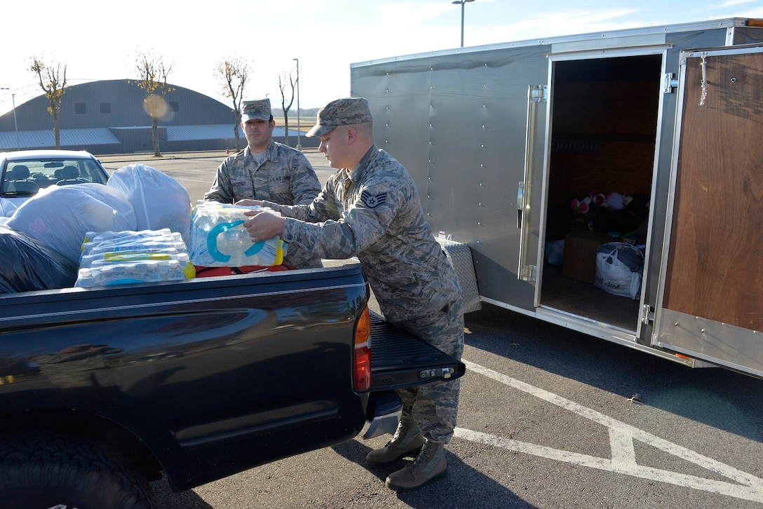 Staff Sgt. Charlie Dunkelberger and Staff Sgt. Logan Shamblin, crew chiefs in the 134th Air Refueling Wing, stepped in to assist with the relief effort following the devastating wild fires that struck Gatlinburg, TN, Dec. 2, 2016 at McGhee Tyson ANGB. (U.S. Air National Guard Photo by Staff Sgt. Ben Mellon)