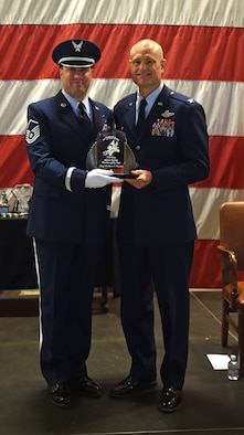 Maste Sgt. Matthew P. Flowers receives the 132d Wing Honor Guard Member of the Year Award from Col. Shawn Ford, commander 132d Wing on November 5, 2016 at the Des Moines Airbase. The award presentation was part of the 132d Wing's annual awards ceremoney. (U.S. Air National Guard photo by Staff Sgt. Michael J. Kelly)