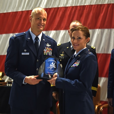 Capt. Renee Rausch receives the 132d Wing Officer of the Year Award from Col. Shawn Ford, commander 132d Wing on November 5, 2016 at the Des Moines Airbase. The award presentation was part of the 132d Wing's annual awards ceremony. (U.S. Air National Guard photo by Staff Sgt. Michael J. Kelly)