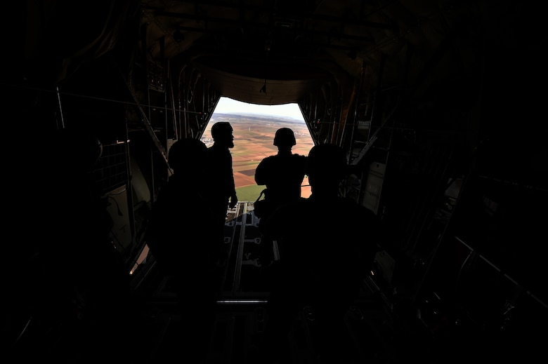 NATO service members wait to jump out of a C-130J Super Hercules assigned to the 37th Airlift Squadron over the skies of Germany, Nov. 30, 2016. As part of International Jump Week, Ramstein Air Base assisted by providing aircraft for the paratroopers to jump from. (U.S. Air Force photo by Senior Airman Jonathan Bass)