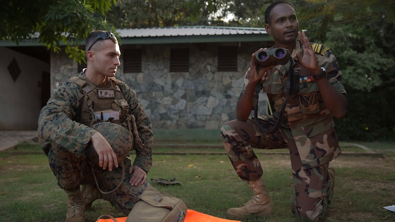 1st Lt. Brandon Hummer, left, teaches a class on optics to Sri Lankan Marines with the assistance of an English translator and Sri Lankan Marine during a Theater Security Cooperation engagement at Sri Lanka Naval Base, Trincomalee, Nov. 23, 2016. Both the United States and Sri Lanka have a continuing interest in strengthening their partnership based on common interests related to maritime security, humanitarian assistance and disaster relief preparedness, and the security and stability in the region. The 11th MEU, part of the Makin Island Amphibious Ready Group, is operating in the U.S. 7th Fleet's area of responsibility in support of enhancing ties with partner and allied nations in the Indo-Asia-Pacific region.