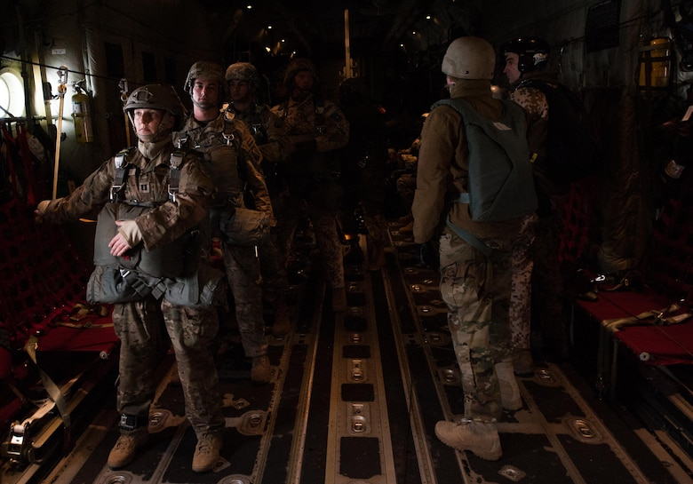 NATO paratroopers stand by on a C-130J Super Hercules before they jump during an International Jump Week exercise over Germany Dec. 1, 2016. The aircraft and aircrew transported more than 50 NATO servicemembers to a drop zone northeast of Ramstein Air Base, Germany as part of multi-national training. (U.S. Air Force photo by Airman 1st Class Lane T. Plummer)