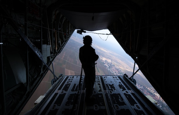Senior Airman Patrick Cassidy, 37th Airlift Squadron loadmaster, observes as North Atlantic Treaty Organization paratroopers jump out of a C-130J Super Hercules during an International Jump Week exercise over Germany Dec. 1, 2016. Cassidy oversaw dozens of NATO Allied nation service members as they took part in training. (U.S. Air Force photo by Airman 1st Class Lane T. Plummer)
