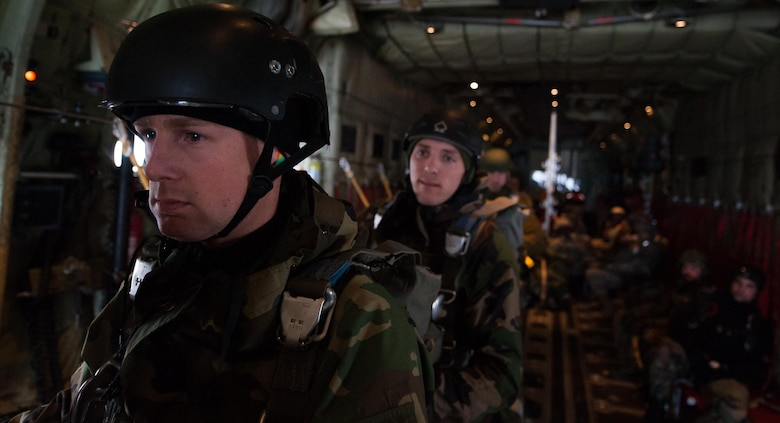 NATO allied nation paratroopers stand by on a C-130J Super Hercules before they jump during an International Jump Week exercise over Germany Dec. 1, 2016. The most recent iteration of the exercise occurred Nov. 28-Dec. 2, and crews from Ramstein's 37th Airlift Squadron assisted in the paratroopers' mission by flying them to their drop zone. (U.S. Air Force photo by Airman 1st Class Lane T. Plummer)