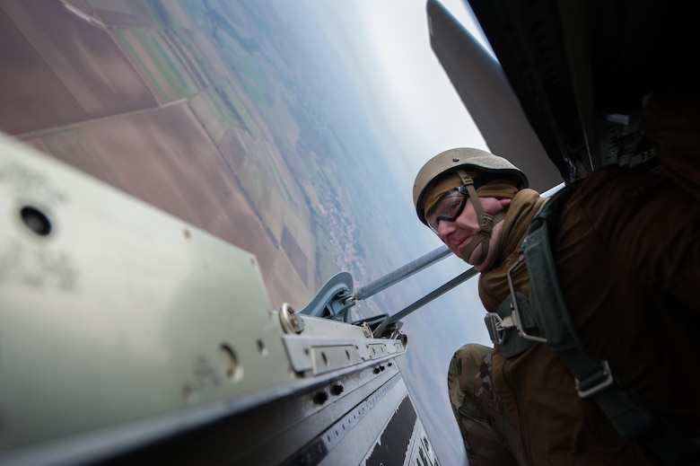 A U.S. Army soldier looks out the sides of a ramp of a C-130J Super Hercules before paratroopers jump out during an International Jump Week exercise over Germany Dec. 1, 2016. As part of the exercise, Ramstein Air Base assisted by providing aircraft for the paratroopers to jump from. (U.S. Air Force photo by Airman 1st Class Lane T. Plummer)