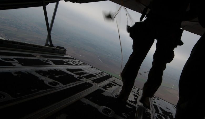 NATO allied nation paratroopers jump out the back of a C-130J Super Hercules during an International Jump Week exercise over Germany Dec. 1, 2016. As part of the exercise, Ramstein Air Base assisted by providing aircraft for the paratroopers to jump from. (U.S. Air Force photo by Airman 1st Class Lane T. Plummer)