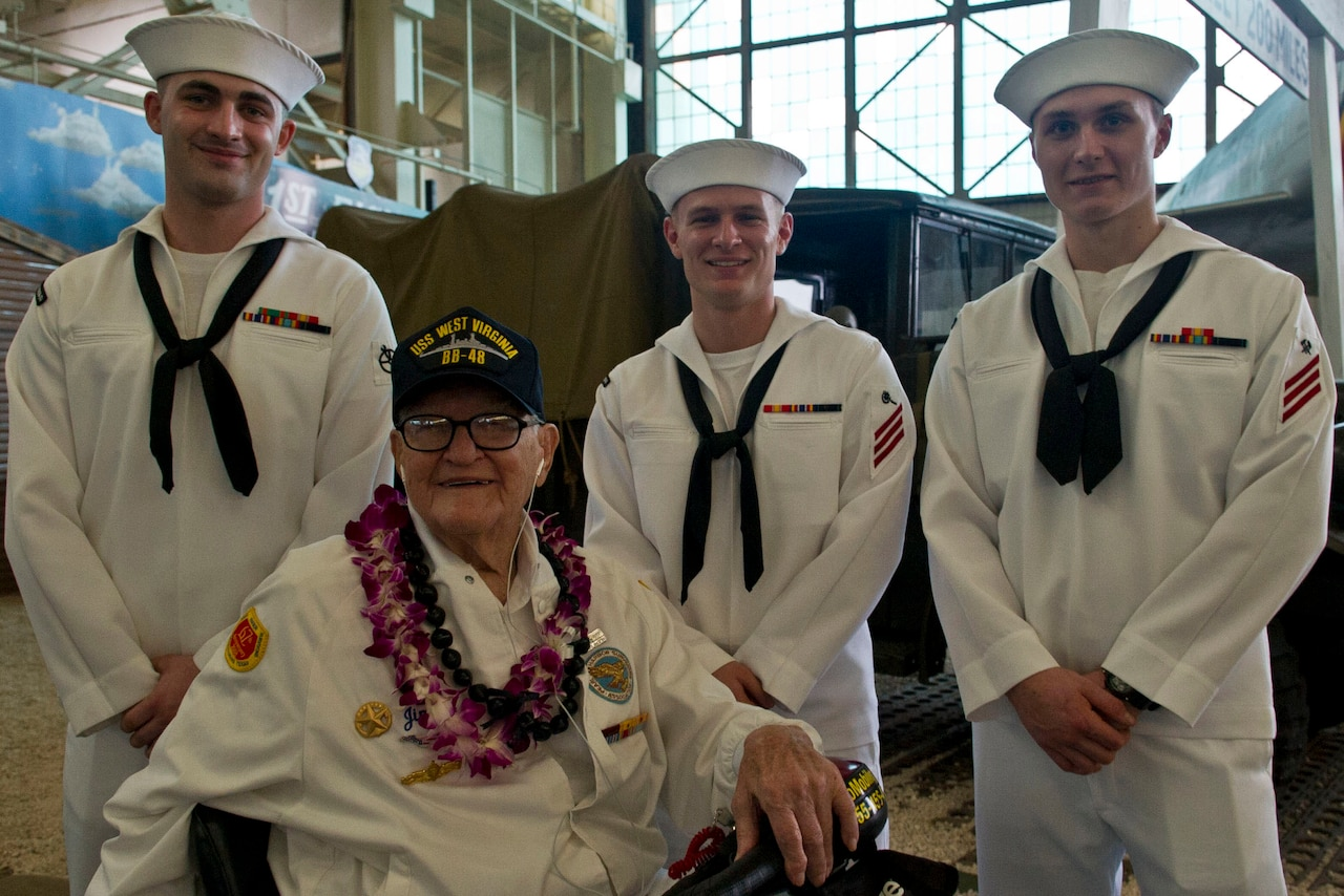 """Pearl Harbor survivor Jim Downing visits with sailors at a screening of the """"Remember Pearl Harbor"""" documentary at the Pacific Aviation Museum at Pearl Harbor, Hawaii, Dec. 4, 2016. DoD photo by Lisa Ferdinando"""