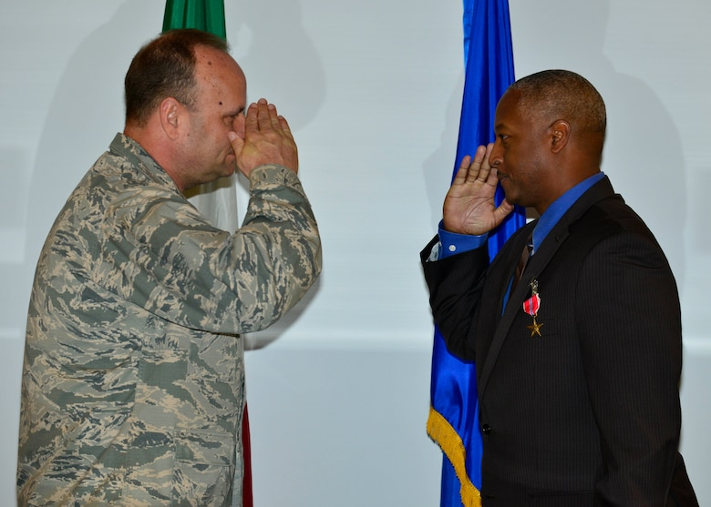 Special Agent Robert Binns, Air Force Office of Special Investigations Detachment 531 superintendent, salutes Brig. Gen. Keith Givens, AFOSI commander, during his Bronze Star Medal presentation at Aviano Air Base, Italy on Dec. 5, 2016. Binns earned the medal by distinguishing himself by meritorious achievement while engaged in operations against an opposing force in Afghanistan from Dec. 7, 2012 to Dec. 10, 2013. (U.S. Air Force photo by Senior Airman Cary Smith)