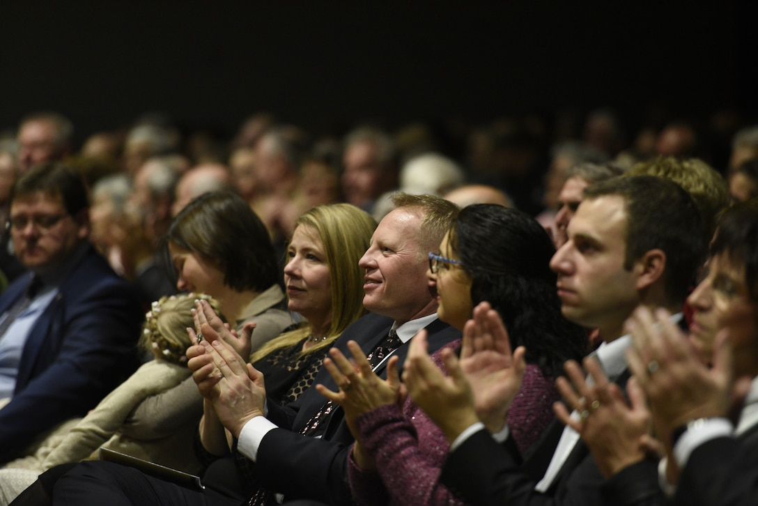 Col. Joe McFall, center, 52nd Fighter Wing commander, attends the U.S. Air Forces in Europe Concert band at City Hall, Bitburg, Germany, Dec. 3, 2016. The band played holiday songs as a way to say thank you to the community members who support USAFE installations. (U.S. Air Force photo by Staff Sgt. Jonathan Snyder)