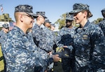Sailors greet one another during a commissioning ceremony Nov. 10, 2016 in San Diego. DLA Troop Support led a Joint Clothing and Textiles Governance Board meeting Nov. 17 with Department of Defense senior logistics leaders to discuss management of clothing and textiles, such as the Navy Working Uniform shown here, during an executive board in Alexandria, Virginia.