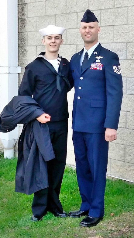 AEDC outside machinist and Tech. Sgt. Eric Brumley pauses for a photo with his son, Seaman Trevor Brumley, after Trevor's basic training graduation in 2015. Eric returned from deployment in Qatar Nov. 5 and will retire from the Air National Guard Jan. 4, 2017. (Courtesy photo)