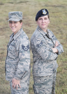 Senior Airman Kaley Weir (right), 802nd Security Forces Squadron corrections specialist, and Staff Sgt. Codi Goodwin, 359th Medical Group health service management craftsman, pose for a photo at Joint Base San Antonio-Lackland Medina Annex Nov. 2, 2016. The fraternal twin sisters have been stationed together at Joint Base San Antonio-Lackland and JBSA-Randolph, respectively, since 2013. (U.S. Air Force photo by Airman 1st Class Lauren Parsons/Released)