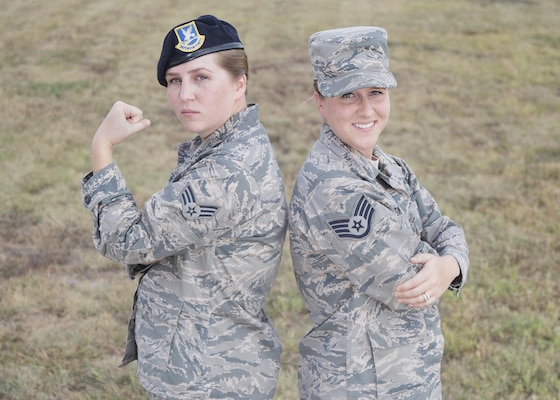 Senior Airman Kaley Weir (left), 802nd Security Forces Squadron corrections specialist, and Staff Sgt. Codi Goodwin, 359th Medical Group health service management craftsman, pose for a photo at Joint Base San Antonio-Lackland Medina Annex Nov. 2, 2016. The fraternal twin sisters have been stationed together at Joint Base San Antonio-Lackland and JBSA-Randolph, respectively, since 2013. (U.S. Air Force photo by Airman 1st Class Lauren Parsons/Released)