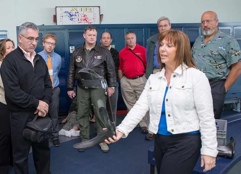 Lori Leal, Center for the Intrepid secretary, explains the capabilities of the Intrepid Dynamic Exoskeletal Orthosis to civic leaders from Joint Base McGuire-Dix-Lakehurst Nov. 30, 2016 at Joint Base San Antonio-Ft. Sam Houston, Texas. The civic leaders also toured a C-5M Super Galaxy aircraft, the Medical Training and Education Campus at Joint Base San Antonio-Ft. Sam Houston. (U.S. Air Force photo by Benjamin Faske)