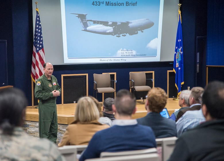 Col. Thomas K. Smith, Jr., 433rd Airlift Wing commander, gives the wing's mission brief to nearly 30 civic leaders from Joint Base McGuire-Dix-Lakehurst, New Jersey Nov. 30, 2016 at Joint Base San Antonio-Lackland, Texas. The civic leaders also toured a C-5M Super Galaxy aircraft, the Medical Training, and Education Campus at JBSA-Ft. Sam Houston, and the Center for the Intrepid. (U.S. Air Force photo by Benjamin Fiske)