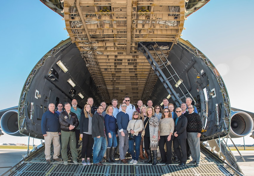 Civic leaders from Joint Base McGuire-Dix-Lakehurst stand on the ramp of a C-5M Super Galaxy aircraft Nov. 30, 2016 at Joint Base San Antonio-Lackland, Texas. The civic leaders also toured the Medical Training and Education Campus at JBSA-Ft. Sam Houston, and the Center for the Intrepid. (U.S. Air Force photo by Benjamin Fiske)