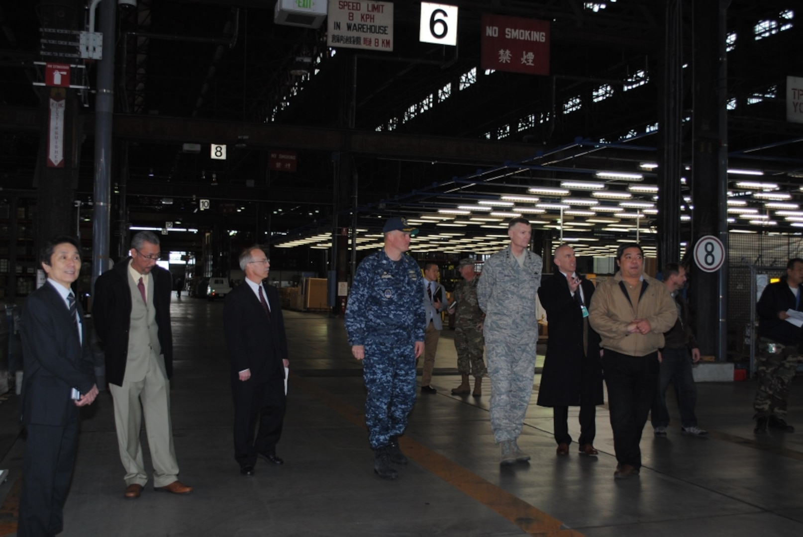 DLA Director Air Force Lt. Gen. Andy Busch joins DLA Distribution leaders on a tour of the Yokosuka facility in 2016.