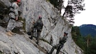 Soldiers from the Army Reserve and German Armed Forces take a rock climbing class at the Mountain Warfare School at Mittnewald.
