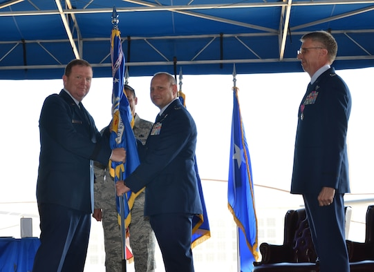 Col. Kurt Matthews (center) assumed command of the 920th Rescue Wing, Patrick Air Force Base, Florida, Dec. 3 in a change of command ceremony officiated by Maj. Gen. Richard W. Scobee, 10th Air Force commander, Naval Air Station Fort Worth Joint Reserve Base, Texas (left). Matthews replaced Col. Jeffrey L. Macrander (right) who served as the 920th RQW commander from August 2011 to December 2016. Approximately 400 civilian and military guests attended. (U.S. Air Force photo./1st Lt. Anna-Marie Wyant)