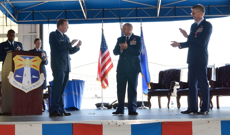 Col. Kurt Matthews (center stage) assumed command of the 920th Rescue Wing, Patrick Air Force Base, Florida, Dec. 3 in a change of command ceremony. Matthews replaced Col. Jeffrey L. Macrander (right) who served as the 920th RQW commander from August 2011 to December 2016. Maj. Gen. Richard W. Scobee (left), 10th Air Force commander, Naval Air Station Fort Worth Joint Reserve Base, Texas, officiated the ceremony that approximately 400 civilian and military guests attended. (U.S. Air Force photo./1st Lt. Anna-Marie Wyant)