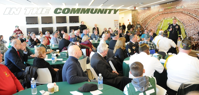 Maj. Gen. Troy D. Kok, commanding general of the U.S. Army Reserve's 99th Regional Support Command headquartered at Joint Base McGuire-Dix-Lakehurst, New Jersey, addresses roughly 100 Vietnam Veterans during an appreciation event hosted Dec. 4 by the National Football League's New York Jets.