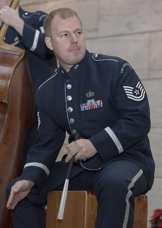 Tech. Sgt. David McDonald, U.S. Air Force Band's Airmen of Note drummer, plays a percussion instrument at the National Museum of American History in Washington, D.C., Dec. 3, 2016. The group played a total of six 30-minute sets spanning the weekend and highlighted compositions by James Taylor and other artists. (U.S. Air Force photo by Senior Airman Jordyn Fetter)