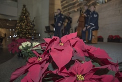 """The U.S. Air Force Band's Airmen of Note performs amid Christmas decorations at the National Museum of American History in Washington, D.C., Dec. 3, 2016. The group of five played their combination of holiday classics titled """"High Flight"""" over a two-day period for museum visitors. (U.S. Air Force photo by Senior Airman Jordyn Fetter)"""