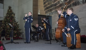"""The U.S. Air Force Band's Airmen of Note performs at the National Museum of American History in Washington, D.C., Dec. 3, 2016. The group of five played their combination of holiday classics titled """"High Flight"""" over a two-day period for museum visitors. (U.S. Air Force photo by Senior Airman Jordyn Fetter)"""